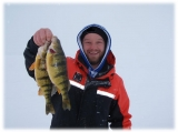 Izaak with a pair of twins caught on one of many cold blustery days in 2014.